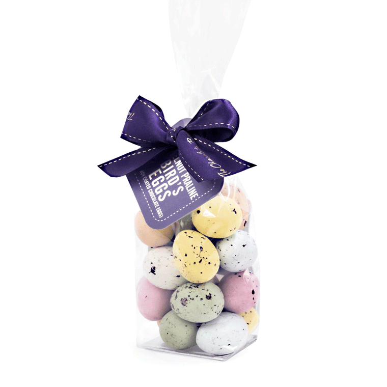 Hazelnut praline birds eggs with candy shells in cello bag.