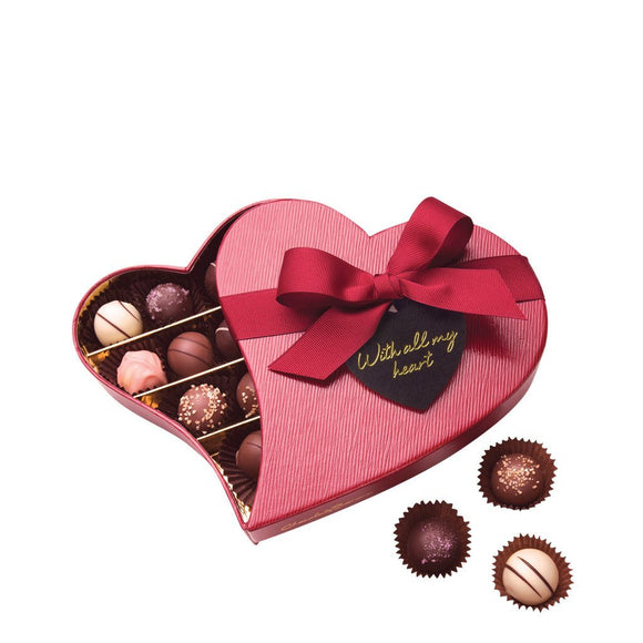 "chocolate truffles in deep red heart shaped box with tag reading ""with all my love"""
