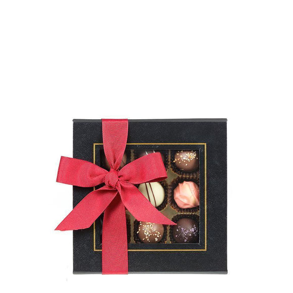 Black Box Chocolate Truffles 9 piece box, Original Style with Happy Easter tag and yellow ribbon.