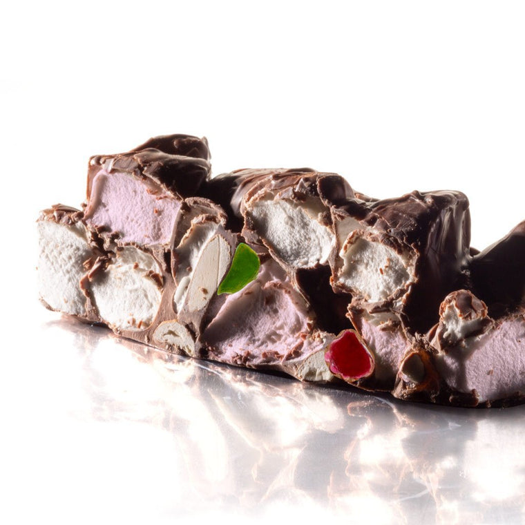 Rocky road bonbon, slab of rocky road chocolate with green and red jellies and white and pink marshmallows