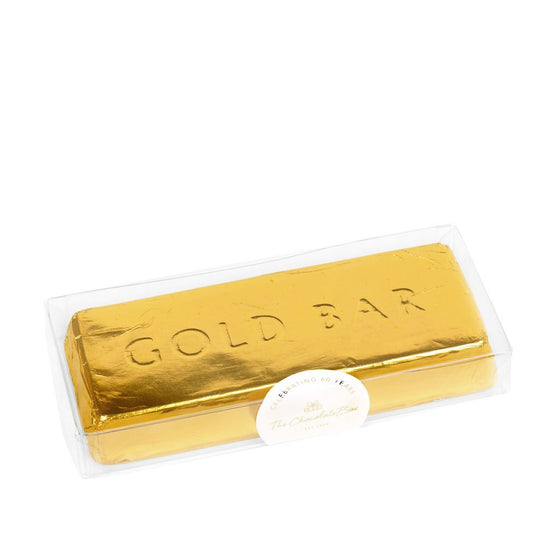 "Milk solid chocolate gold bar, in the shape of a gold ingot, wrapped in in gold foil, with the words ""GOLD BAR"" engraved into the chocolate"