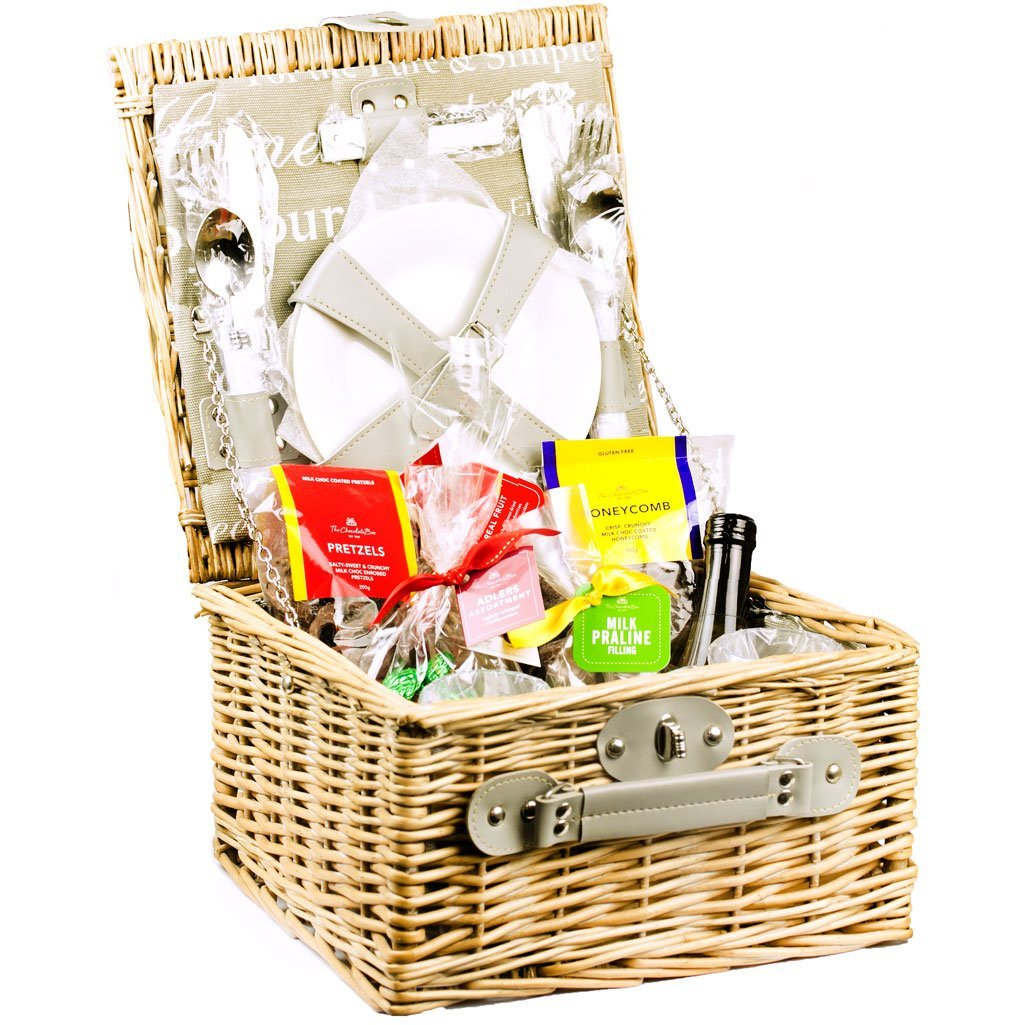 Picnic Basket with plates, cups, cutlery and The Chocolate Box chocolate products and small wine bottle.