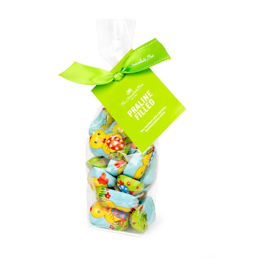 hazelnut praline filled mini chicks in brightly coloured foil chick design, 250g bag
