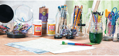 Image of a collection of arts supplies such as glue, paint, and brushes