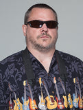 Picture of Ryan Fluery wearing sunglasses and a shirt with Guitars on it