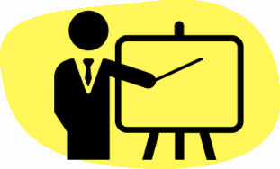 Image of a man pointing at a whiteboard