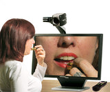 Woman applying makeup with Acrobat HD ultra Electronic Magnifier