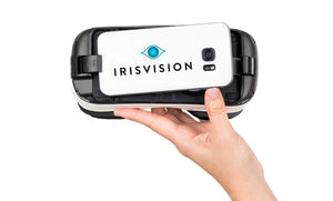 Image of the IrisVision Wearable Low Vision Aid being held in hand.