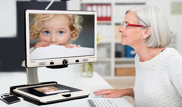 Woman using Merlin Elite Pro to look at picture