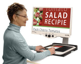 Woman using Merlin Ultra to view recipes