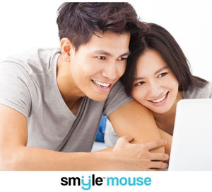Image of a couple using a laptop and smiling