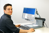 Image of a man using the Visio500 to enlarge a computer desktop