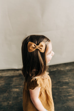 June// Distressed Tan Leather Bow