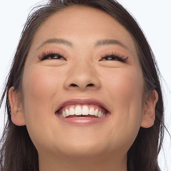 girl smiling with eyelash extensions
