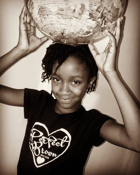 Young african american girl holding up a world globe wearing a black perfect brown T-shirt