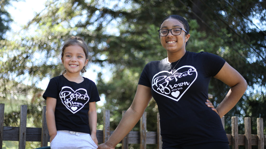 african american sisters happy smiling wearing black perfect brown t-shirts