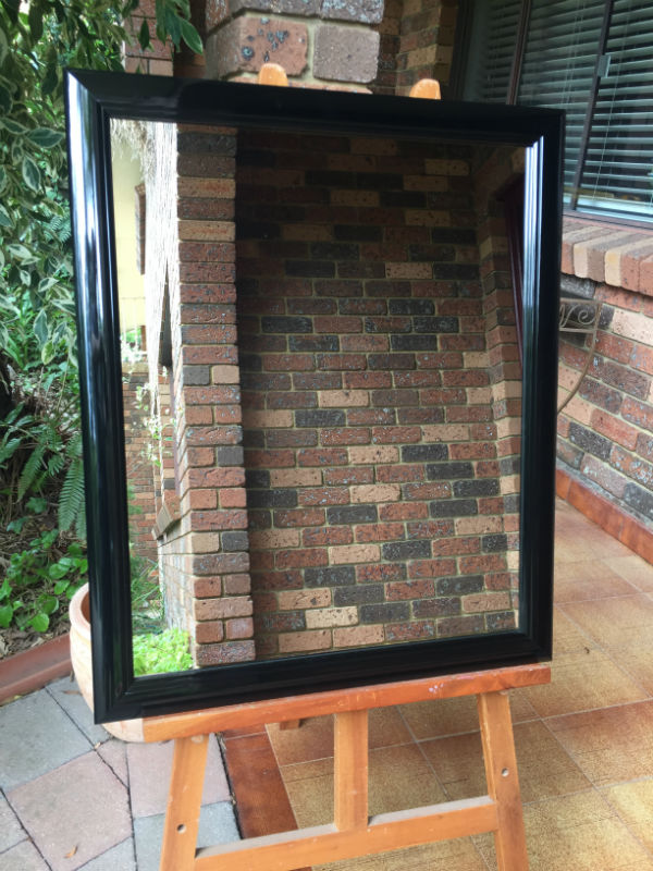 High Gloss Black Finish Timber Framed Wall Mirror.