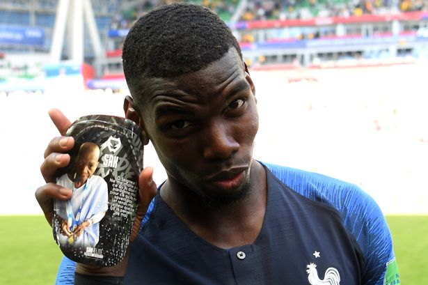World Cup Champion Paul Pogba with his customized SAK shin guard honouring his father.