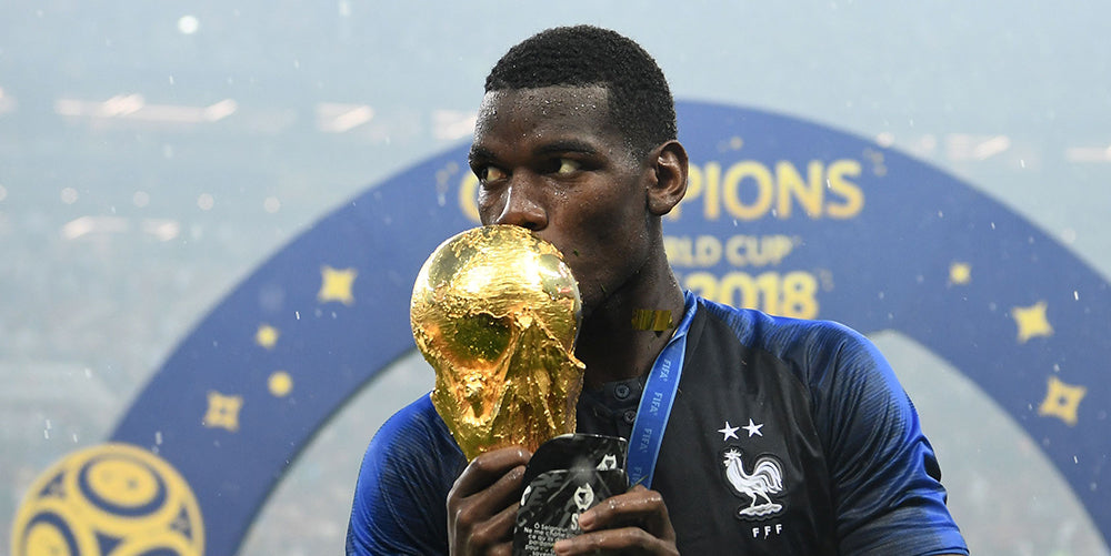 French National Team and Manchester United star Paul Pogba lifts the World Cup trophy and keeps him father closes to him with an inspiring SAK shin guard.