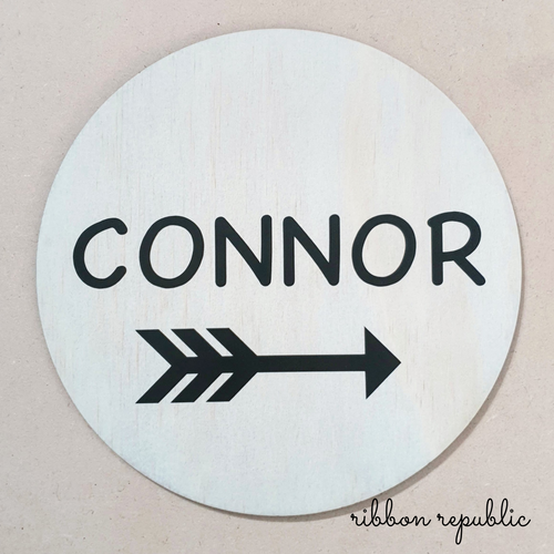 Personalised arrow wall plaque.