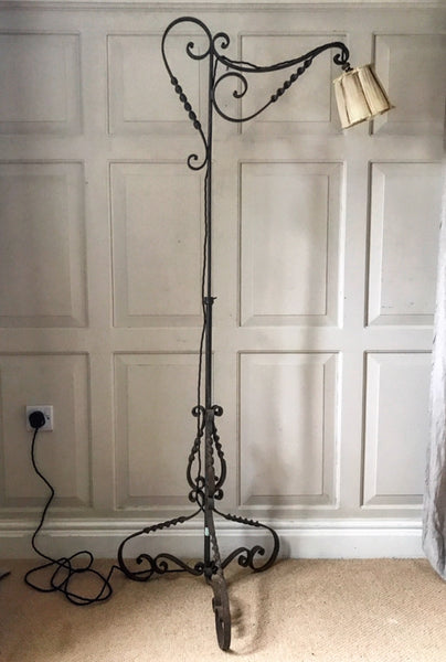 Early 20th century Italian hand-forged adjustable wrought iron lamp.