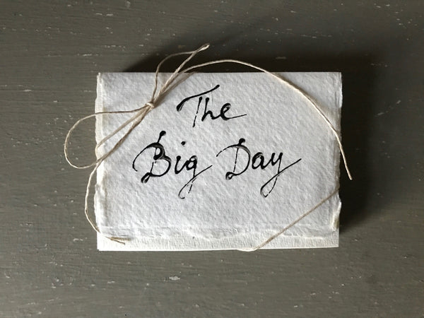 Handwritten THE BIG DAY cards with matching envelopes on handmade paper.
