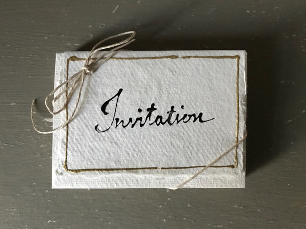 Handwritten INVITATION cards with matching envelopes on handmade paper.