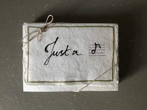 Handwritten JUST A 'NOTE' cards with matching envelopes on handmade paper.