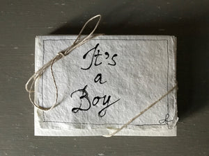 Handwritten IT'S A BOY cards with matching envelopes on handmade paper