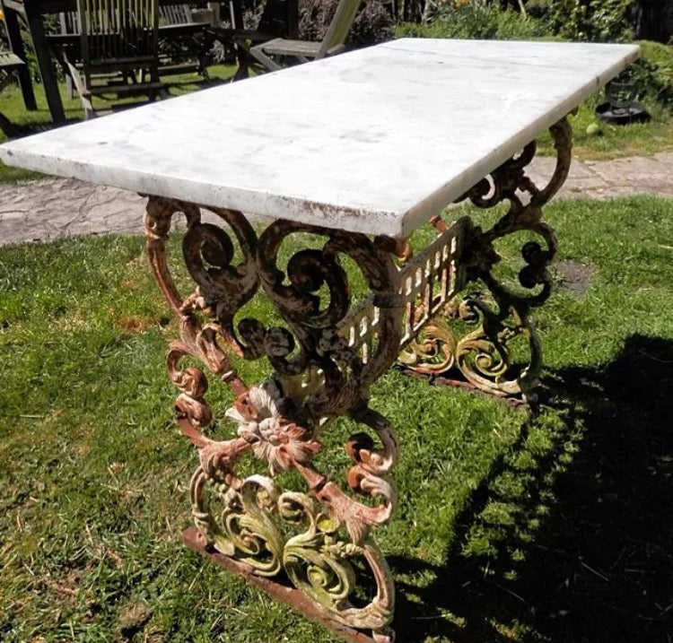 19th century Colebrookdale style cast iron table with marble top.