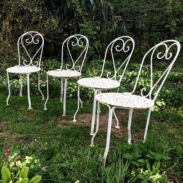 Late 19th century French wrought iron cafe chairs.