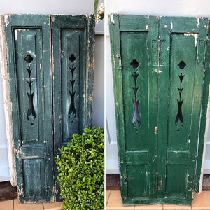 Early 20th century French shutter in original paint and time-weathered patina.