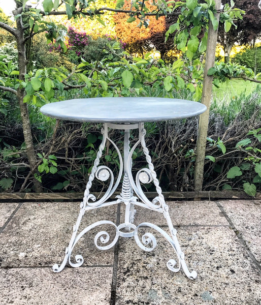 19th century fer forge French filigree wrought iron table base with contemporary zinc top.