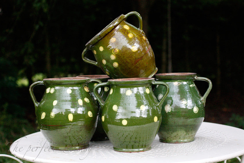 Handmade Vintage Hungarian spotty jug in deep green glaze.