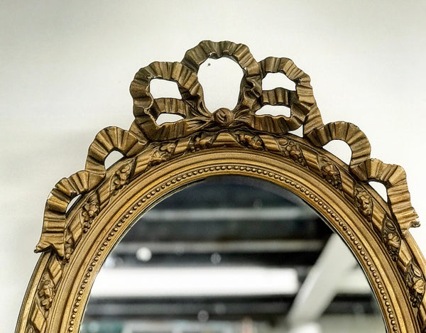 Late 19th century French oval wood and gesso frame mirror.