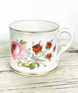 19th century cup with hand decorated roses and gilt monogram.