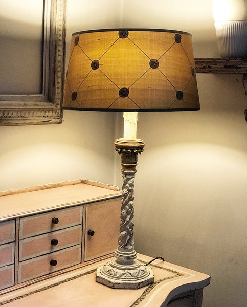 Early 20th century decorative table lamp with silk shade.
