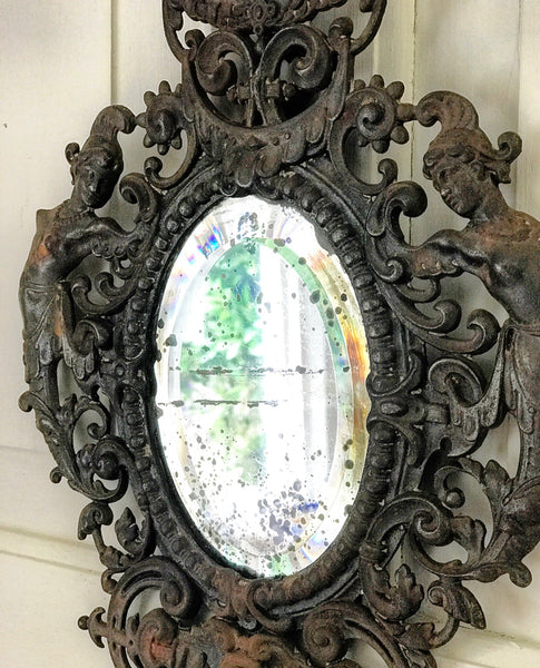 Late 19th century Italian iron-frame mirror in Rococo style with original glass plate.