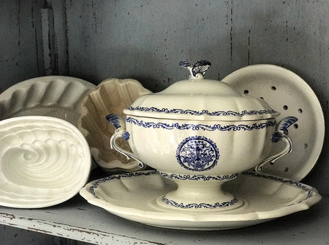 19th century French Gien ceramic faience saucier with shell motif.