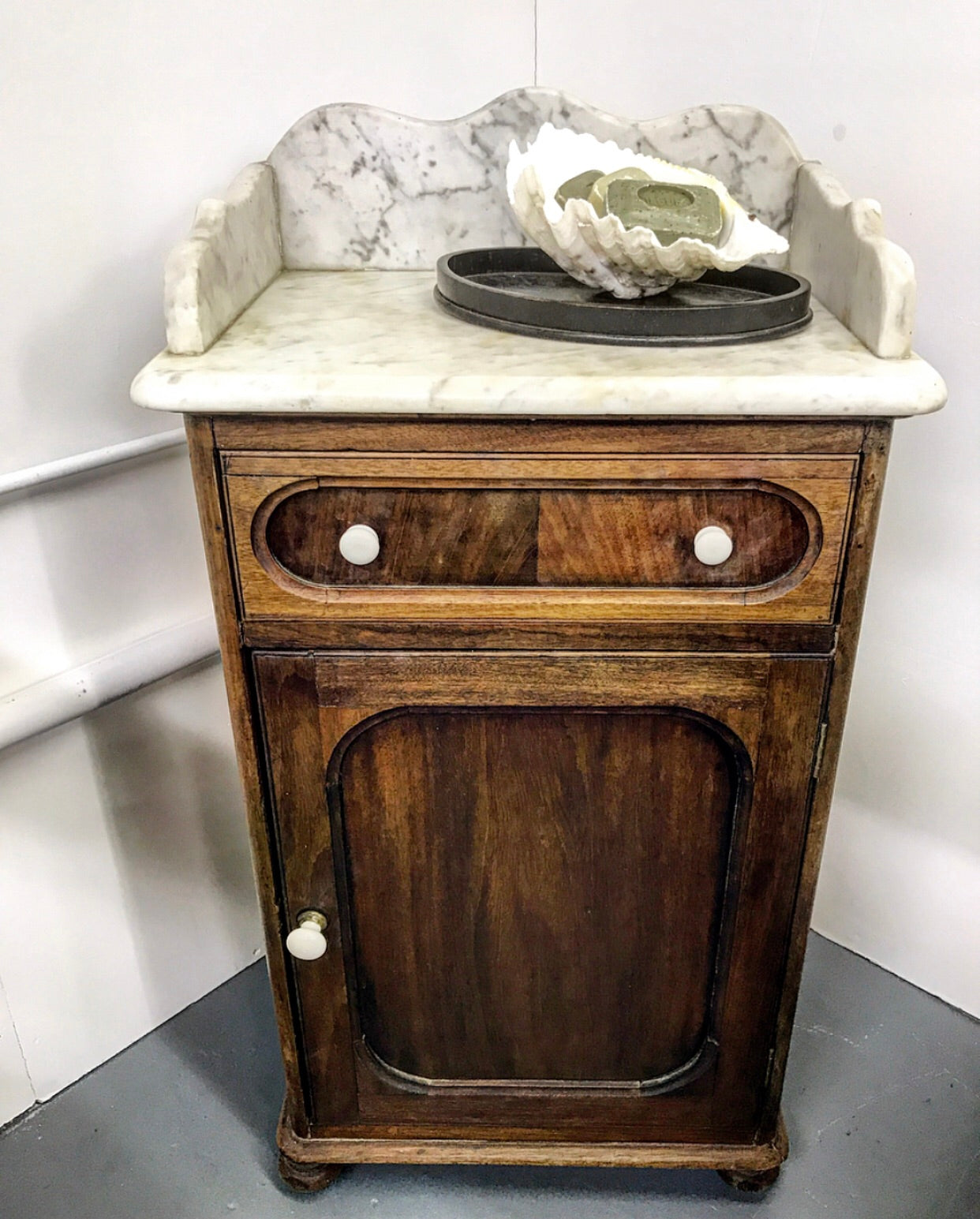 19th century pot cupboard with Carrara marble top and original ceramic knobs.