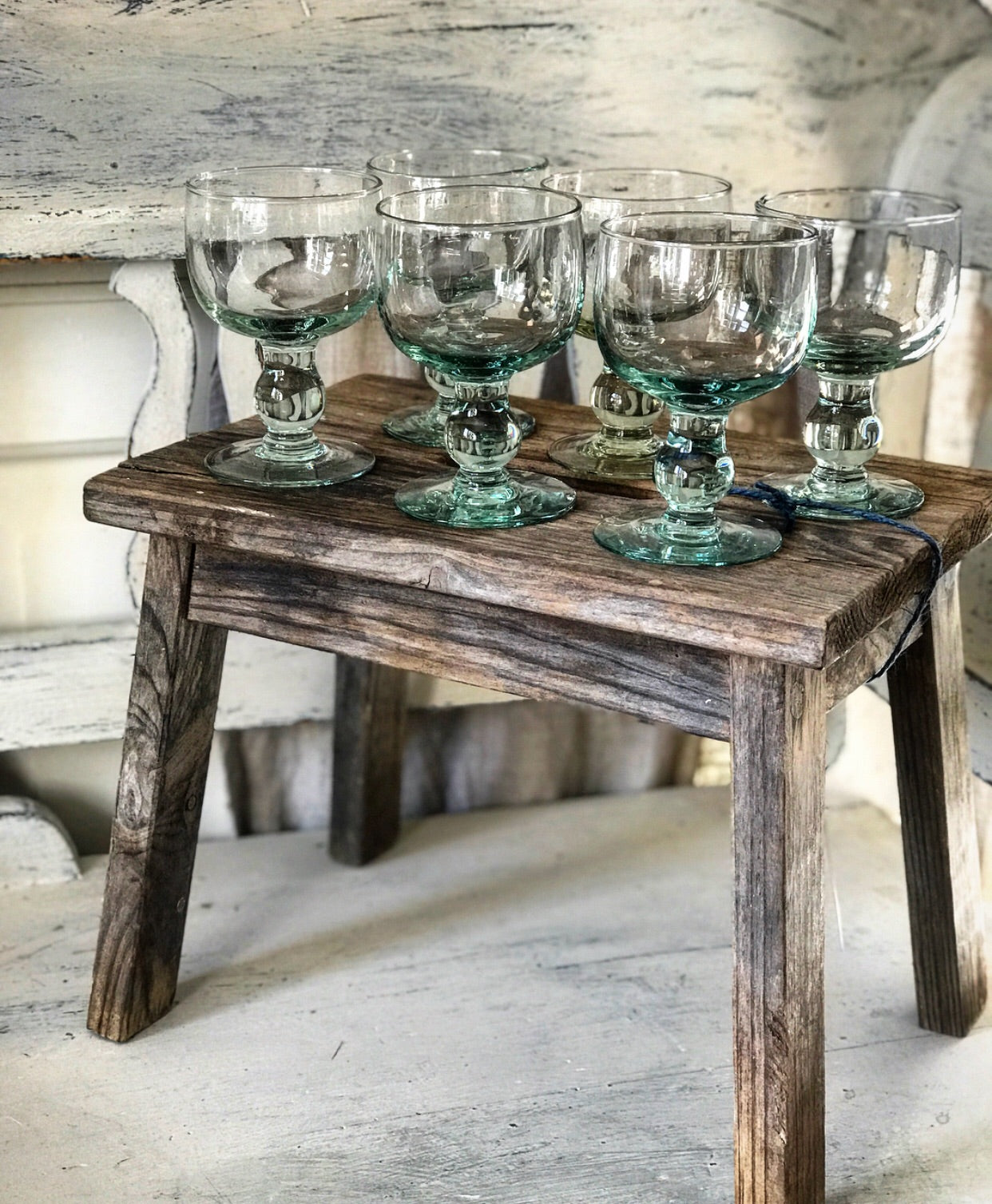 Old handmade French wine goblets on footed stem.
