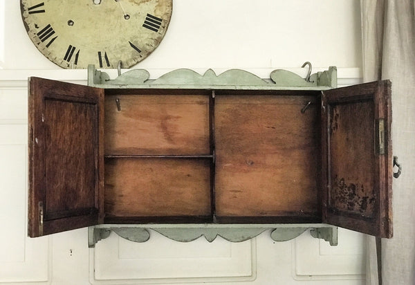 1920's Oak wall-hung cabinet with sectioned interior.