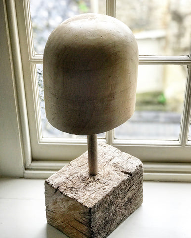 Early 20th century Milliners Block on antique base.