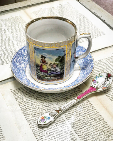 19th century coffee can with later saucer and ceramic spoon.