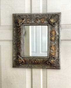 Early 20th century mirror in a decorative Art Deco frame.