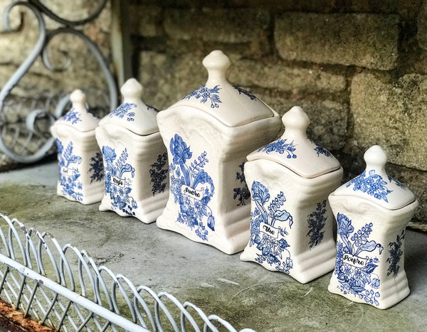 Set of 5 French ceramic storage pots with lids.