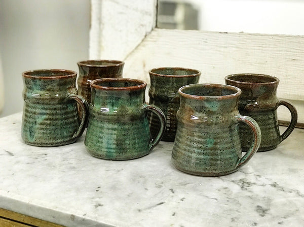 Set of 6 hand-thrown pottery mugs in forest green glaze.