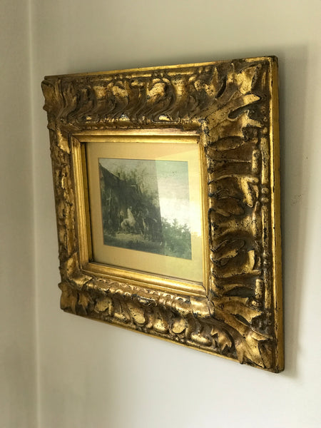 Old 18th century style picture in a gilt frame.