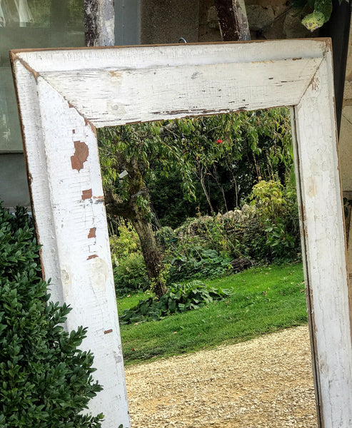 An old French door-frame mirror.