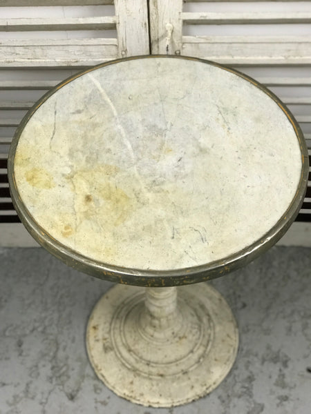Early 20th century metal Parisian cafe table with marble top.